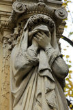 Detail of a mourning sculpture on a Pere Lachaise cemetery in Paris Stock Image