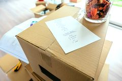Detail of move checklist. Over stack of moving boxes Royalty Free Stock Images