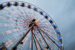 Moving Ferris wheel with lights stock images