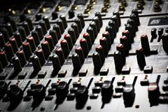 Music mixer desk. Detail of a music mixer desk with various knobs royalty free illustration