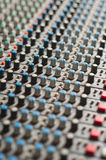 Detail of a music mixer in studio, closeup. Royalty Free Stock Images