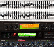 Detail of music mixing console. With lots of knobs and buttons Royalty Free Stock Images