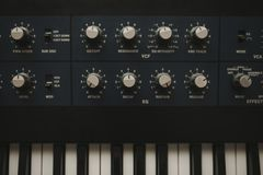Detail of musical synth keyboard and control buttons. royalty free stock images