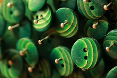 Green knobs, in the dust, pinned buttons. Detail on my piece of art, pinned buttons in canvas, with fine bokeh Royalty Free Stock Image