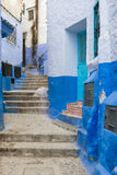 Detail of a narrow street in the mountain town of Chefchaouen with blue buildings, in Morocco Royalty Free Stock Photo
