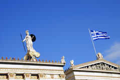 Detail of The National Academy of Athens (Greece). Detail of The National Academy of Athens in Greece, showing the statue of Athena (Minerva) and the Greek flag Stock Photography