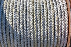 Coiled rope on a winch on a sailboat stock photo