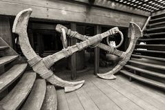 Detail of Neptune Galleon shop in Genoa, Italy - two old anchors. Genoa, Italy - May 14, 2017: Two old anchors in the interior of the Galleon Neptun old wooden royalty free stock photos
