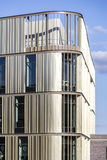 Detail of New Build. A close-up of part of a new office block with blue sky Royalty Free Stock Image