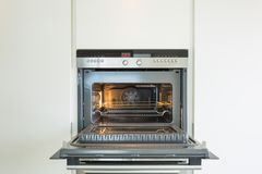Detail of modern oven. Detail of new oven. door is open and light is on Stock Images