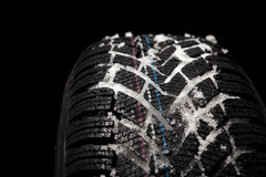 Detail new winter tire with snow Stock Images
