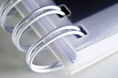 Detail of a notebook. This image shows a detail of a notebook binder Royalty Free Stock Photo
