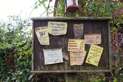 Detail of a notice board with many notices in Hobbiton in Matamata, New Zealand Stock Photo