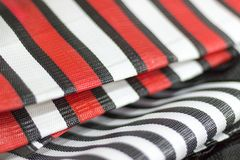 Detail of nylon bags with red and black stripes royalty free stock photos