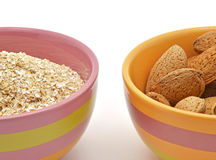 Detail of oat bran and almonds Stock Photography