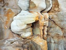 Wind and Water Erosion of Sandstone Cliff, Manly, Australia. Detail of ocean side sandstone cliff rocks heavily wind and water eroded or weathered, making a semi stock photos