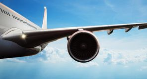 Free Detail Of Commercial Airplane Flying Above Clouds Stock Photography - 123583732