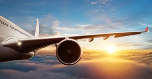 Free Detail Of Commercial Airplane Flying Above Clouds Stock Images - 123583774