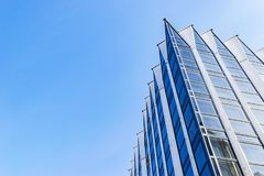 Free Detail Of Office Building Exterior. Business Buildings Skyline Looking Up With Blue Sky. Modern Architecture Apartment. High Tech Stock Photography - 115499582