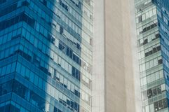 Detail of an office and business building in Mexico City. Detail of an office and business building with blue and turquoise windows on the South Insurgentes stock photography