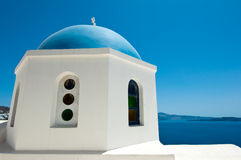 Detail of Oia church with blue cupola on the island of Thera (Santorini).  Royalty Free Stock Image