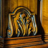 Detail of a inlaid wood furniture. Detail of an oiled inlaid antique wood furniture Royalty Free Stock Image