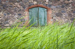Detail of an old Barn with entrance gate Stock Image