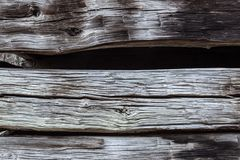 Detail of old barn exterior showing stacked hand hewn beams. Horizontal aspect Stock Image