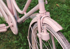 Detail of old bicycle with the bottle dynamo on the front wheel Stock Photo