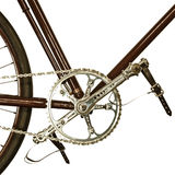 Detail of an old bicycle isolated on white Royalty Free Stock Photos