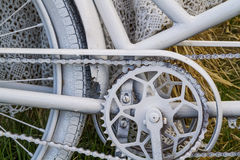 Detail of an old bicycle painted white Royalty Free Stock Photos