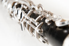 Detail of a old black clarinet on white background stock photography