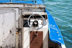Detail of an old boat stops at the port. Wheel of an old boat stops at the port Royalty Free Stock Image