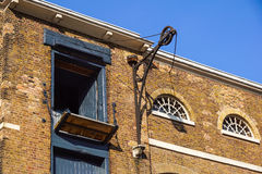 Detail of old brick building in England with loading doors Stock Images
