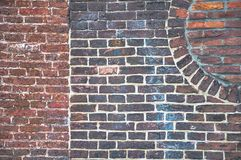 Detail from an old brick wall with different patterns visible. On its surface royalty free stock photo