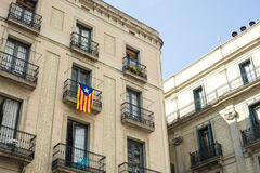 Detail of old building and a independentist catalan flag at Sant Stock Photos