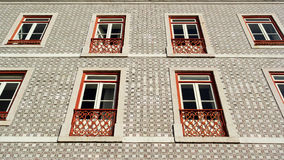 Detail of an old building with portuguese tiles and red and whit Stock Photography