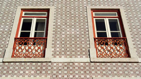 Detail of an old building with portuguese tiles and red and whit Royalty Free Stock Photography