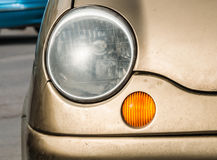 Detail of old car headlight. Royalty Free Stock Images