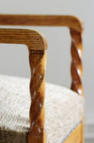 Detail of an old chair, wooden spiral arm Royalty Free Stock Image