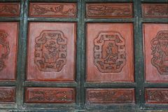 Detail old Chinese door. Carved with longevity, prosperity, sign stock images