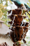 Detail of an old classic style stone fountain with flowing water Royalty Free Stock Photos