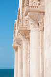 Detail of old columns and sea. Detail of old architecture and blue sea background Stock Photo