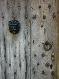Detail of old cotswold wooden door with metal face. Royalty Free Stock Image