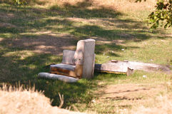 Garbage in nature. Detail of old couch near a forest site with heap of garbage Royalty Free Stock Photography