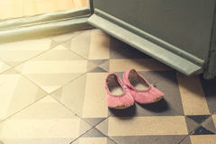 Detail of old and damaged child`s pink dancing slippers or shoes stock image