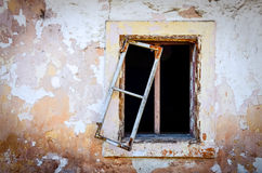 Detail of old damaged window and textured cracked wall Stock Photography