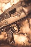 Machine gun trigger closeup. Detail of an old disused machine gun used in Balkan war in Serbia on display Royalty Free Stock Photography