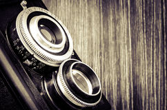Detail of old fashioned camera in vintage style Royalty Free Stock Photography