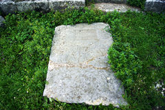 Detail of old gravestone on the grass Stock Images